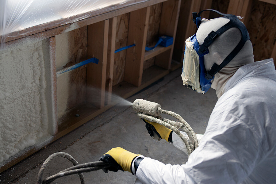 Installer spraying Natural Polymers foam insulation